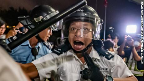 HONG KONG, HONG KONG - JUNE 10: Police officers charge toward protesters after a rally against the extradition law proposal at the Central Government Complex on June 10, 2019 in Hong Kong. Organizers say more than a million marched on Sunday against a bill that would allow suspected criminals to be sent to mainland China for trial as tensions have escalated in recent weeks. (Photo by Anthony Kwan/Getty Images)