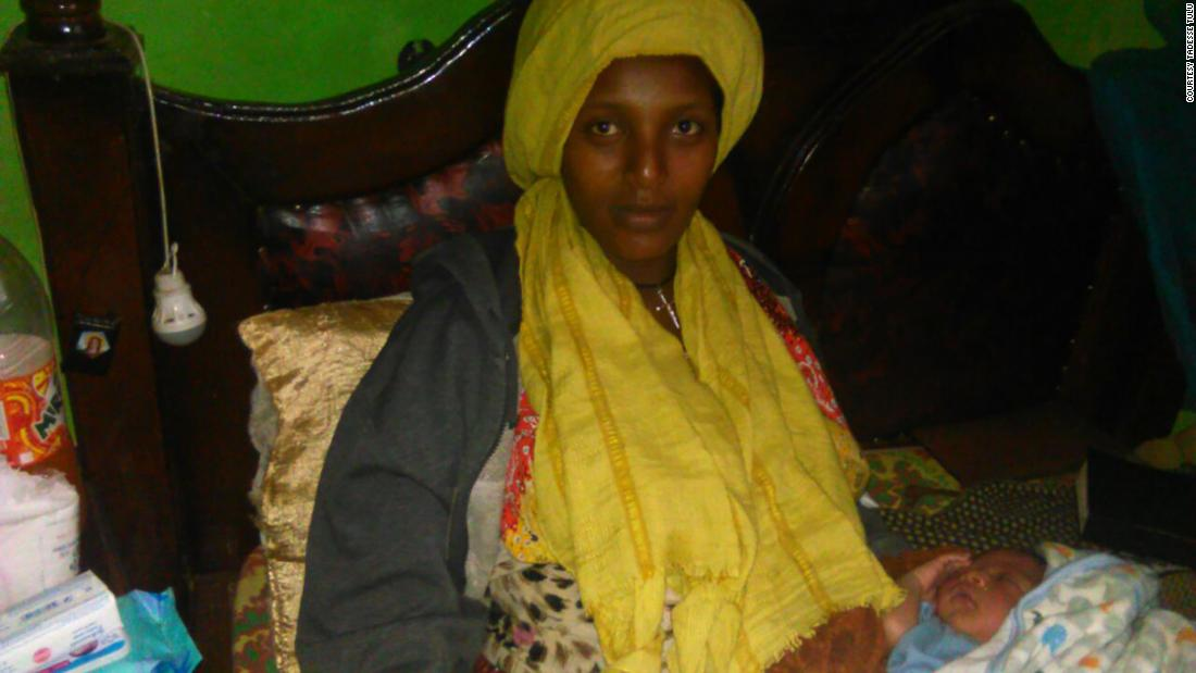 Ethiopian woman sits exam on hospital bed 30 minutes after giving birth