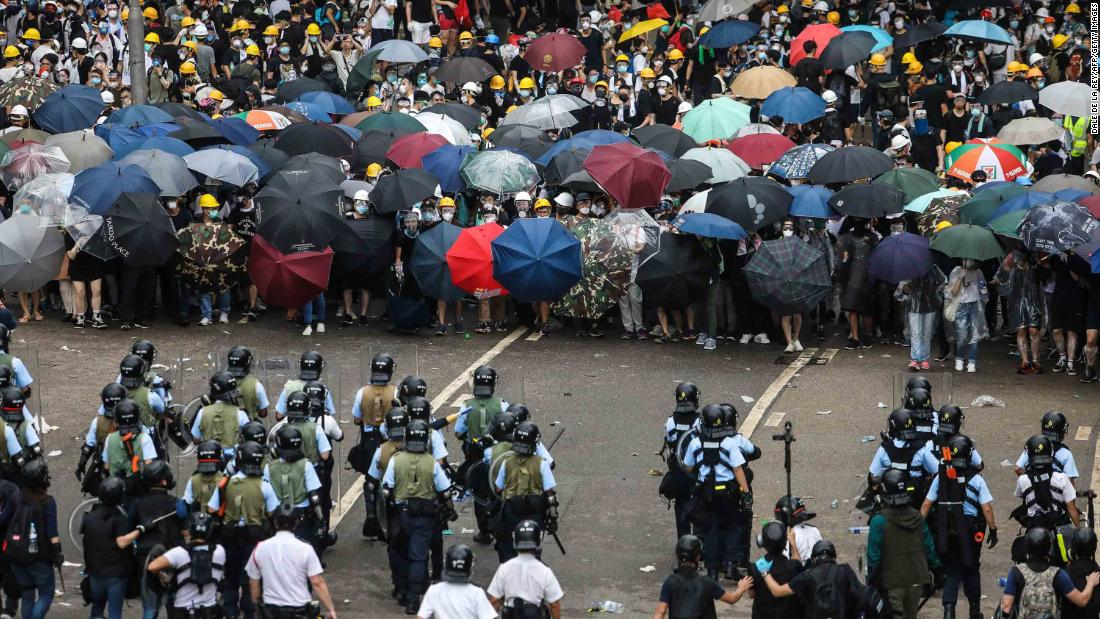Protesters face off with police during the rally on June 12.