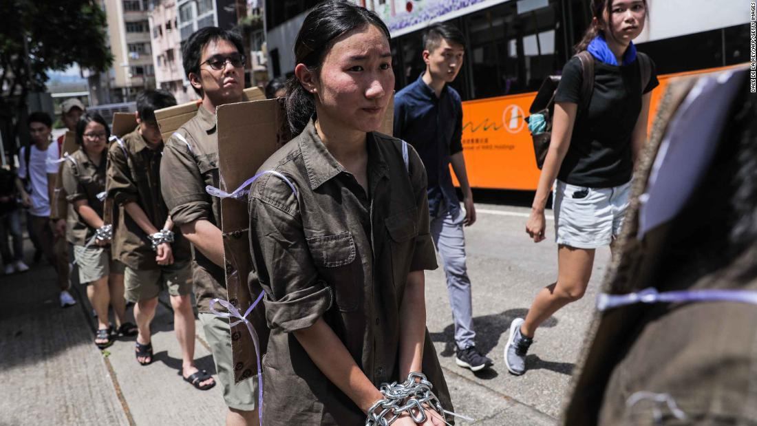 Students wear chains during a demonstration on Saturday, June 8.