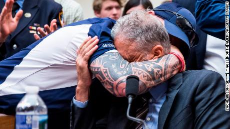 WASHINGTON, DC - JUNE 11: FealGood Foundation co-founder John Feal hugs former Daily Show Host Jon Stewart during a House Judiciary Committee hearing on reauthorization of the September 11th Victim Compensation Fund on Capitol Hill on June 11, 2019 in Washington, DC. The fund provides financial assistance to responders, victims and their families who require medical care related to health issues they suffered in the aftermath of 9/11 terrorist attacks. (Photo by Zach Gibson/Getty Images)