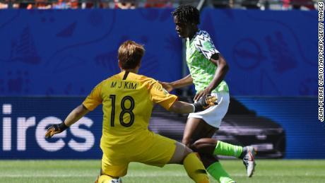 Nigeria's forward Asisat Oshoala (R) reacts as she scores a goal against South Korea.