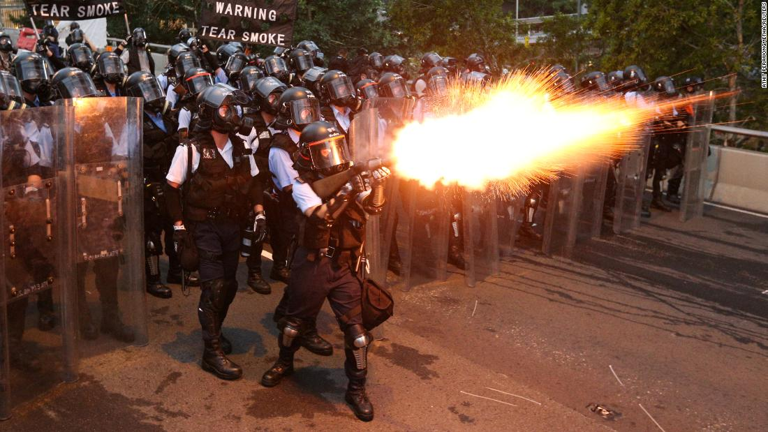 Police officers fire tear gas during the demonstration on June 12.