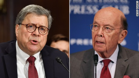 To the left, Justice Minister William Barr and to the right of Minister Wilbur Ross.
