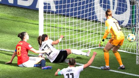 Sara Daebritz of Germany scores her team's first goal against Spain.