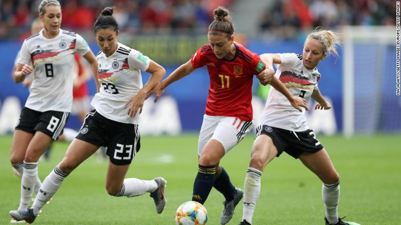 Alexia Putellas of Spain is challenged by Sara Doorsoun and Kathrin Hendrich of Germany.