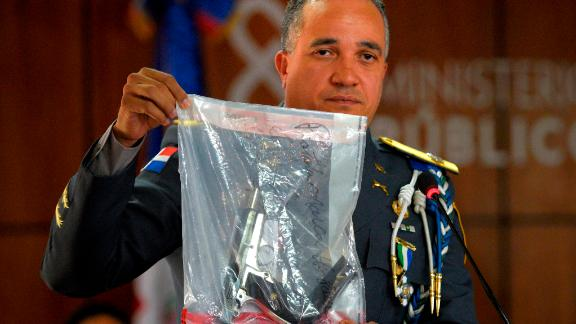 The director of the National Police, General Ney Aldrin Bautista Almonte shows the weapon that was used to shoot former Boston Red Sox slugger David Ortiz, during a press conference at the Attorney General's Office in Santo Domingo, Dominican Republic, Wednesday, June 12, 2019. Six suspects, including the alleged gunman, have been detained in the shooting, the Dominican Republic's chief prosecutor said Wednesday. (AP Photo / Roberto Guzman)