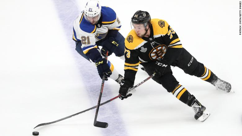 Charlie McAvoy, of the Boston Bruins, is defended by Tyler Bozak, of the St. Louis Blues, during the second period in Game 7.