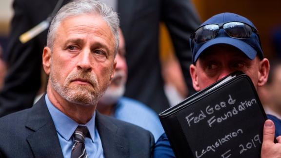 WASHINGTON, DC - JUNE 11: Former Daily Show Host Jon Stewart and FealGood Foundation co-founder John Feal look on during a House Judiciary Committee hearing on reauthorization of the September 11th Victim Compensation Fund on Capitol Hill on June 11, 2019 in Washington, DC. The fund provides financial assistance to responders, victims and their families who require medical care related to health issues they suffered in the aftermath of 9/11 terrorist attacks. (Photo by Zach Gibson/Getty Images)