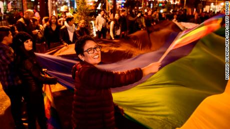 LGBTQ activists in Quito celebrate the court's decision, which ruled in favor of same-sex marriage.