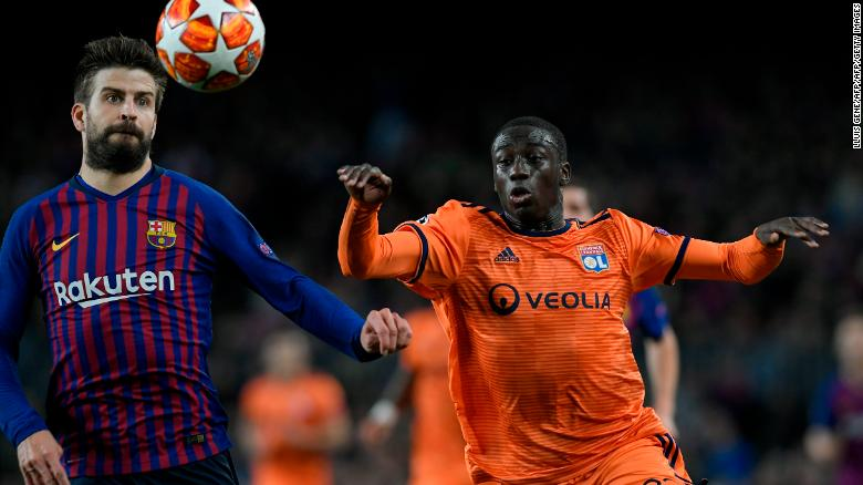 Ferland Mendy competes for the ball against Barcelona's Gerard Pique.