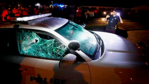 A squad car was damaged in the protests Wednesday in the north Memphis neighborhood of Frayser.