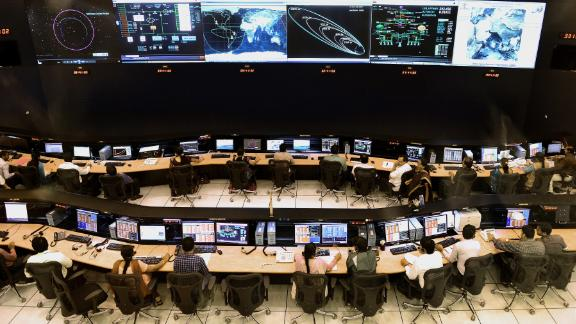 Indian scientists and engineers of Indian Space Research Organization (ISRO) monitor the Mars Orbiter Mission (MOM) at the tracking center, in Bangalore on November 27, 2013.