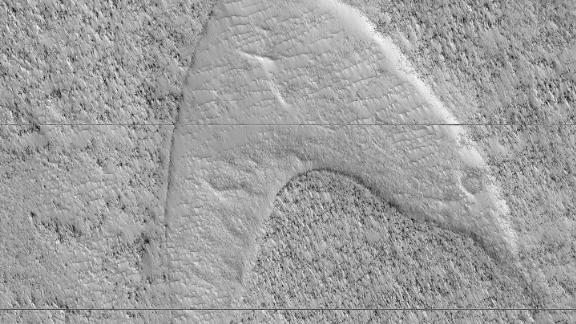 "Cooled lava helped preserve a footprint of where dunes once moved across a southeastern region on Mars. But it also looks like the ""Star Trek"" symbol."