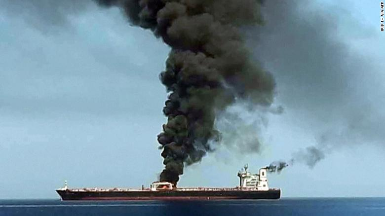 This still, obtained by AFP from Iranian State TV IRIB, purports to show smoke billowing from a tanker said to have been attacked off Oman. CNN has not independently verified this image.