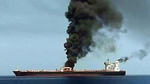 Obtained by AFP from Iranian State TV IRIB reportedly shows smoke billowing from a tanker said to have been attacked off the coast of Oman, at an undisclosed location. CNN has not independently verified this image.