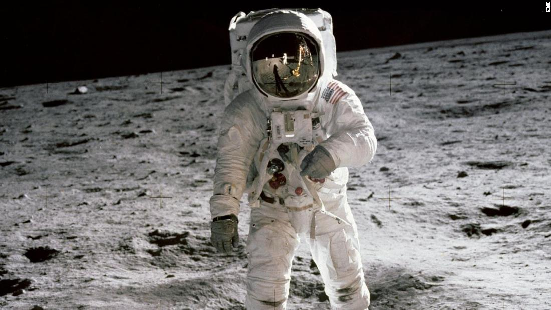 "Aldrin walks on the surface of the moon. He and Armstrong spent a little over two hours collecting rock samples and data near the moon's Sea of Tranquility region. They also left behind a plaque signed by all three crew members and President Richard Nixon. The plaque reads: ""Here men from the planet Earth first set foot upon the moon, July 1969 A.D. We came in peace for all mankind."""