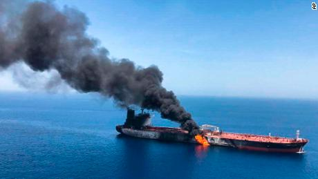 An oil tanker on fire in the sea of Oman, Thursday, June 13, 2019.