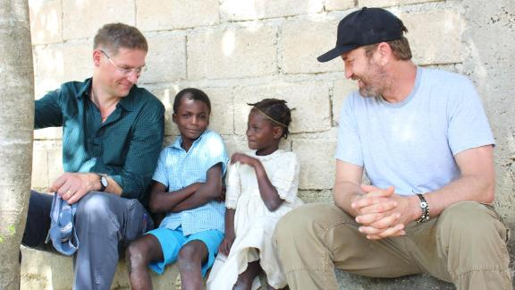 CNN Hero Magnus MacFarlane-Barrow and Gerard Butler in Haiti