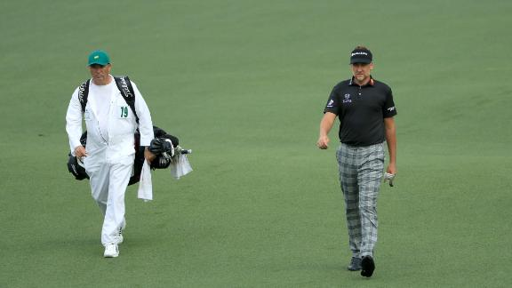 Mundy (left) wearing Augusta's traditional jumpsuit while working for Ian Poulter at the Masters.