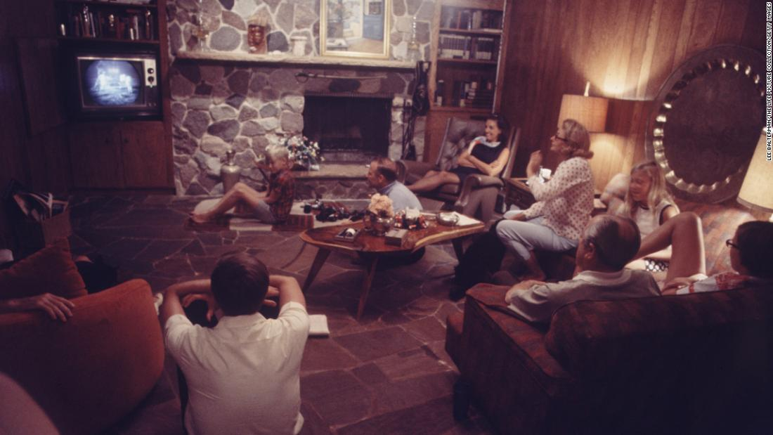 Aldrin's family and friends watch the mission from his home in Texas. Aldrin's wife, Joan, is in the polka-dot shirt. ABC, CBS and NBC spent between $11 million and $12 million to cover the mission from July 20-21.