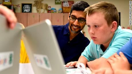 Google CEO Sundar Pichai looks at coding projects designed by 4H students at Roosevelt Elementary in Pryor, Oklahoma, June 13, 2019. Nick Oxford for CNN
