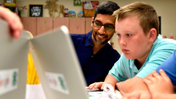 Google CEO Sundar Pichai looks at coding projects designed by 4H students at Roosevelt Elementary in Pryor, Oklahoma.