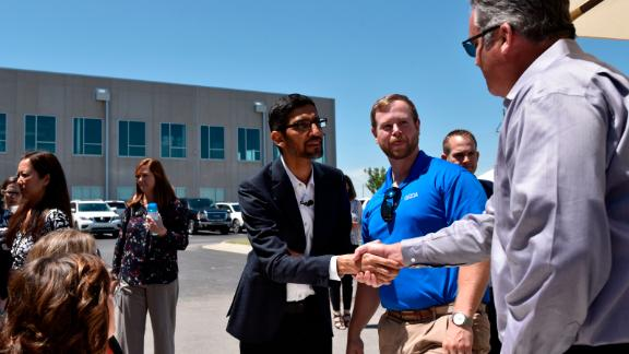 Google CEO Sundar Pichai greets attendees during an event at the company