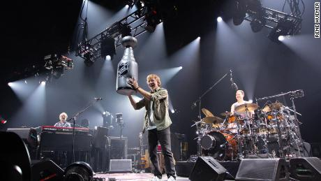 Phish's Trey Anastasio holds a blow-up replica of the Stanley Cup at St. Louis's Chaifetz Arena on June 12, 2019, after the Blues won the Stanley Cup.