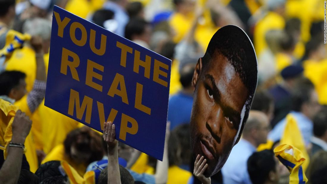 Golden State fans hold a sign for star forward Kevin Durant, who ruptured his Achilles in Game 5.