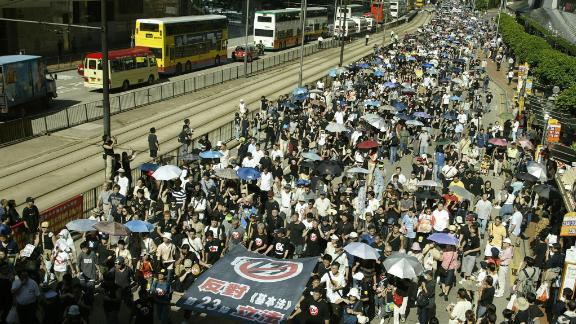 A huge protest  against a controversial anti-subversion law, known as Article 23, in July 2003.
