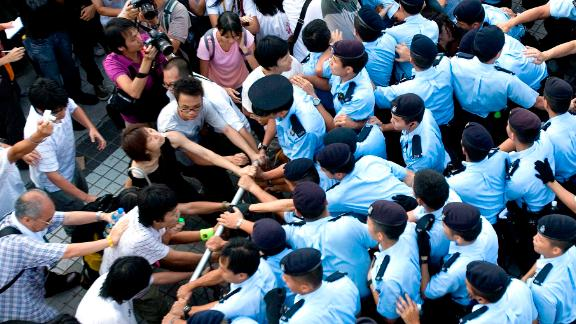 Protesters clash with police at Queen's Pier in Hong Kong, China, in August, 2007.