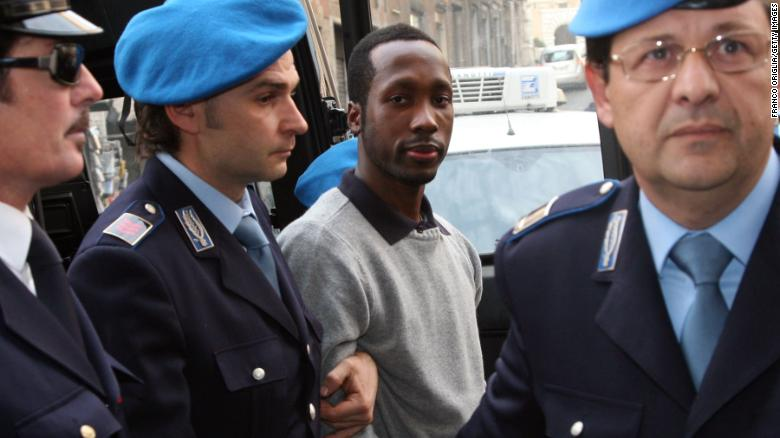 Rudy Guede arrives at the Perugia courthouse for an appeal hearing in 2009.