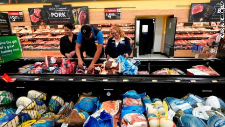 FILE- In this Nov. 9, 2018, file photo Walmart associates stock a frozen meat section at a Walmart Supercenter in Houston. On Tuesday, March 5, 2019, the Institute for Supply Management, a trade group of purchasing managers, issues its index of non-manufacturing activity for February. (AP Photo/David J. Phillip, File)