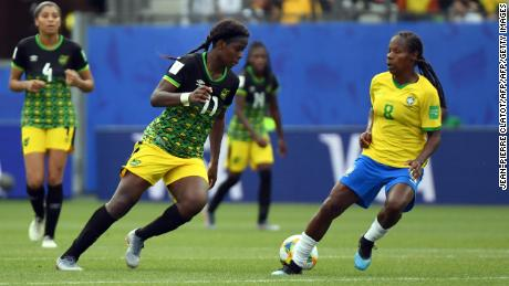 Jamaica's forward Khadija Shaw (L) vies with Brazil's midfielder Formiga (R)  during the France 2019 Women's World Cup Group C football match between Brazil and Jamaica on June 9, 2019, at the Alpes Stadium in Grenoble, central-eastern France. (Photo by Jean-Pierre Clatot / AFP)        (Photo credit should read JEAN-PIERRE CLATOT/AFP/Getty Images)
