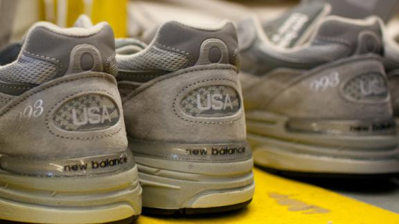 """Finished sneakers wait to be packaged in the New Balance Athletic Shoe, Inc. factory in Lawrence, Massachusetts, U.S. on Friday, Dec. 16, 2011. A shoe that would take about 20 minutes to make in Asia takes two and half minutes to make in the U.S., according to New Balance Chief Executive Officer Robert DeMartini. """"The way we make shoes in the U.S. delivers the same or higher quality at a much lower labor content rate, """" he said in September. Photographer: Scott Eisen/Bloomberg via Getty Images"""