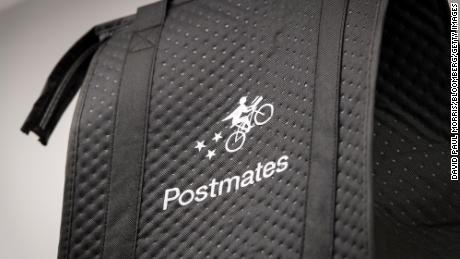 A delivery bag with the Postmates Inc. logo sits on a shelf at the company's headquarters in San Francisco, California, U.S., on Wednesday, May 8, 2019.