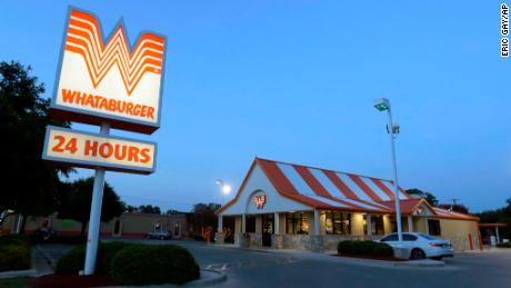 This Thursday, July 9, 2015 photo shows a Whataburger restaurant in San Antonio, Texas. The iconic Texas restaurant chain will not allow the open carrying of guns on its properties, taking a stand against a new law legalizing the practice. (AP Photo/Eric Gay)