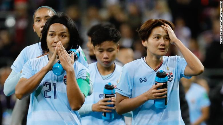Thailand's players react after losing against the USA.