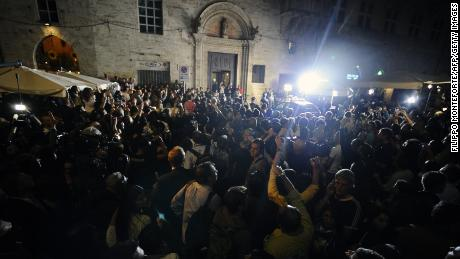 People and media gather outside Perugia's court before the appeal verdict is announced on October 3, 2011.