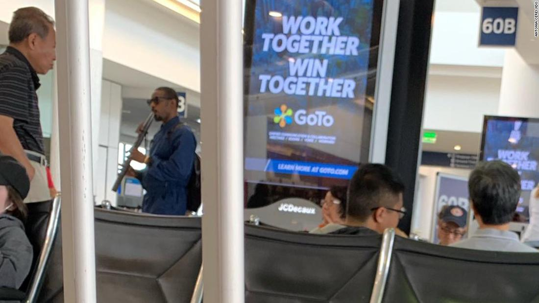 André 3000 is just walking around the airport playing the flute