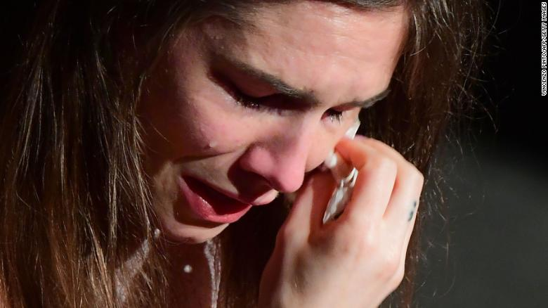 Amanda Knox wipes her tears away during her speech in Modena on Saturday.