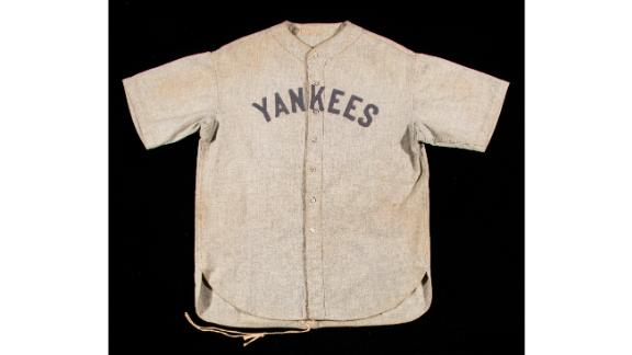 """The road jersey is made of gray flannel and has """"Ruth"""" stitched inside the collar. It also has all of its original buttons, along with original drawstrings at the back."""