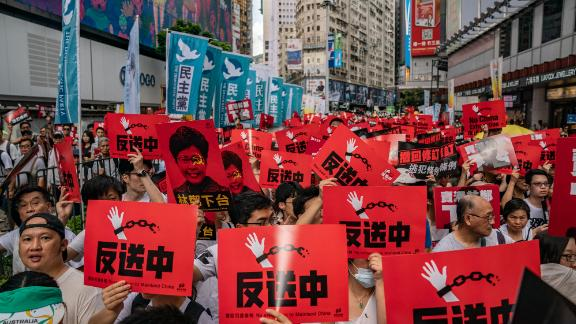 HONG KONG - JUNE 09:  Protesters hold placards and shout slogans during a rally against a controversial extradition law proposal on June 9, 2019 in Hong Kong. Organizers say more than a million protesters marched in Hong Kong on Sunday against a bill that would allow suspected criminals to be sent to mainland China for trial as tensions have escalated in recent weeks.  (Photo by Anthony Kwan/Getty Images)