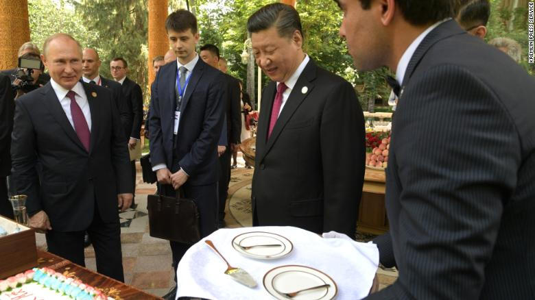 Putin presents Xi with ice cream on his 66th birthday.