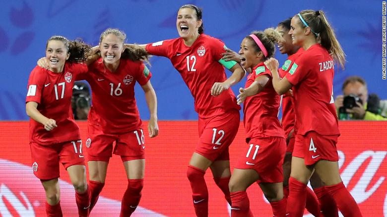 Jessie Fleming celebrates with her Canadian teammates after scoring her team's first goal.