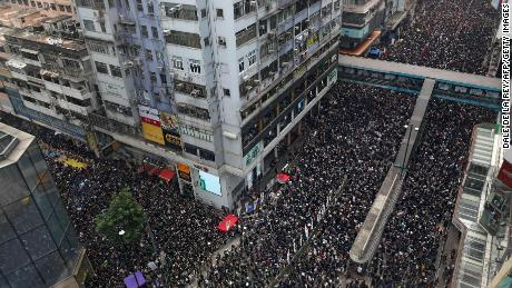 Thousands of protesters dressed in black take part in a new rally against a controversial extradition law proposal in Hong Kong on June 16, 2019. - Tens of thousands of people rallied in central Hong Kong on June 16 as public anger seethed following unprecedented clashes between protesters and police over an extradition law, despite a climbdown by the city's embattled leader. (Photo by Dale DE LA REY / AFP)        (Photo credit should read DALE DE LA REY/AFP/Getty Images)