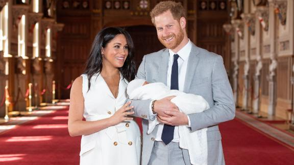 WINDSOR, ENGLAND - MAY 08: Prince Harry, Duke of Sussex and Meghan, Duchess of Sussex, pose with their newborn son Archie Harrison Mountbatten-Windsor during a photocall in St George