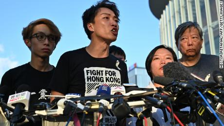Civil Human Rights Front (CHRF) member Jimmy Sham (C) speaks during a press conference in Hong Kong on June 15, 2019 after Hong Kong Chief Executive Carrie Lam suspended a hugely divisive bill that would allow extraditions to China in a major climbdown after a week of unprecedented protests and political unrest. (Photo by HECTOR RETAMAL / AFP)        (Photo credit should read HECTOR RETAMAL/AFP/Getty Images)