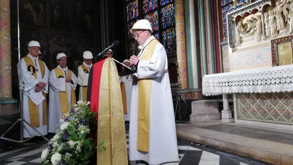 Patrick Chauvet, the rector of Notre Dame Cathedral, delivers an address during the Mass.
